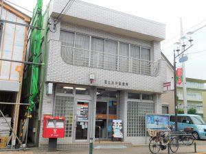 足立本木郵便局:徒歩5分